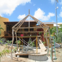 Palapa with wayacan poles at Blue Bay